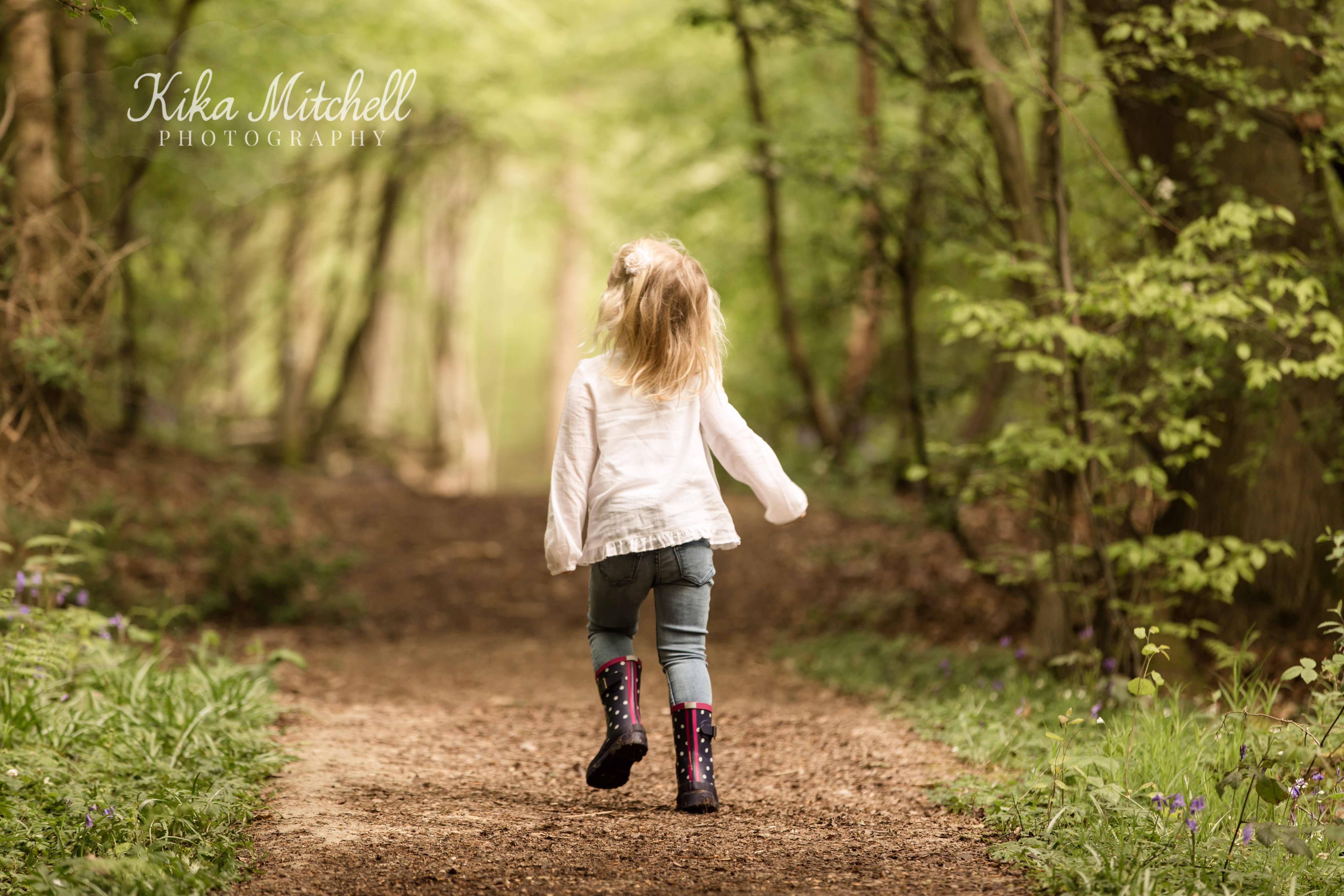 child dancing on outdoor family photoshoot by Kika Mitchell Photographer Chelmsford photographer