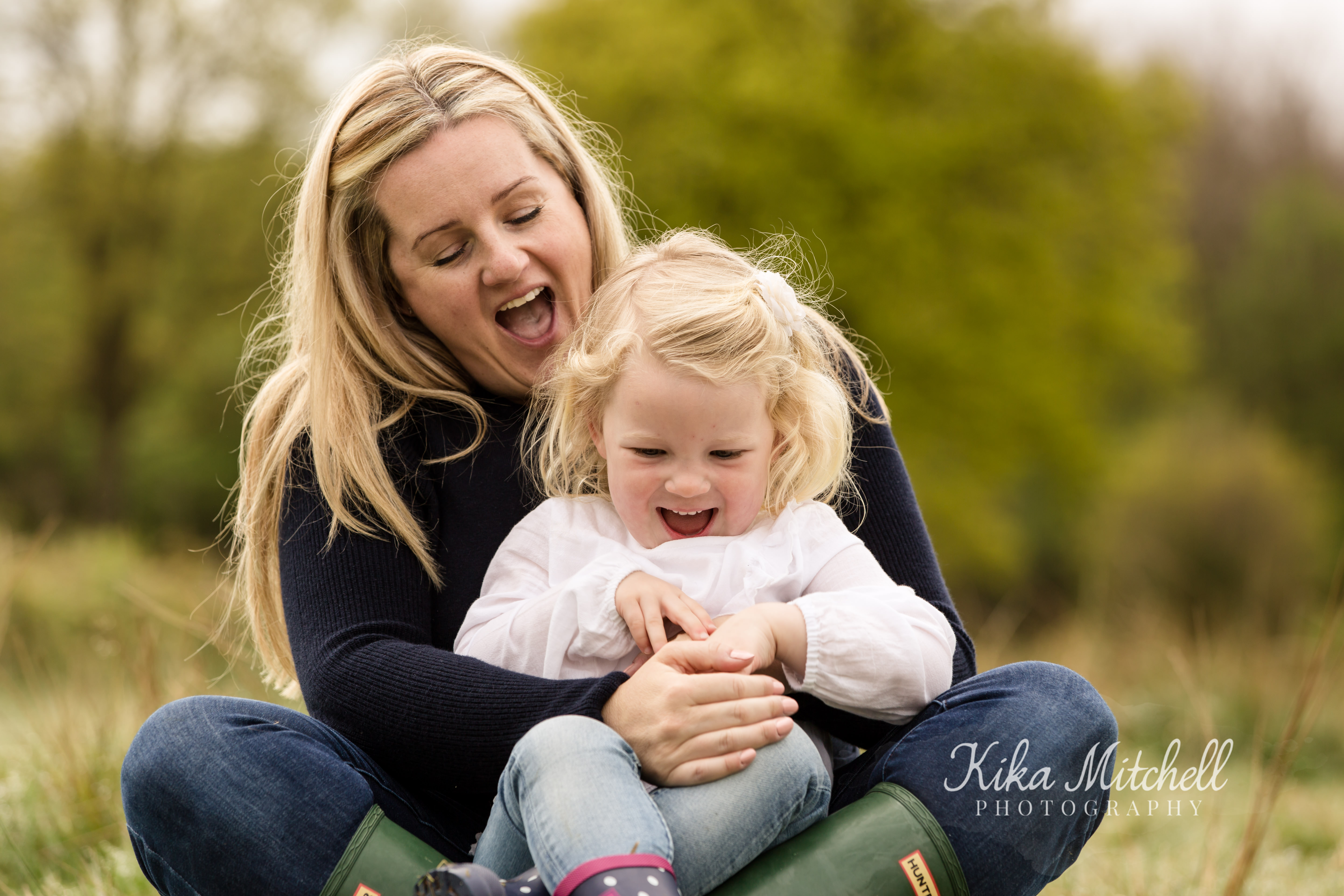 laughing family in outdoor shoot Chelmsford with Kika Mitchell photography