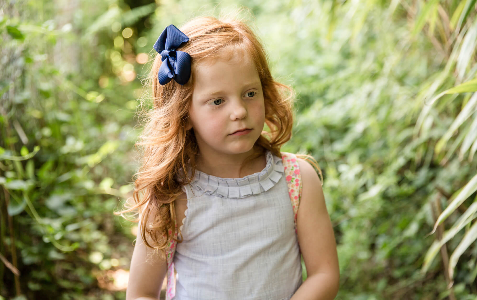 Redhead child on outdoor family shoot by Chelmsford family photographer Kika Mitchell Photography