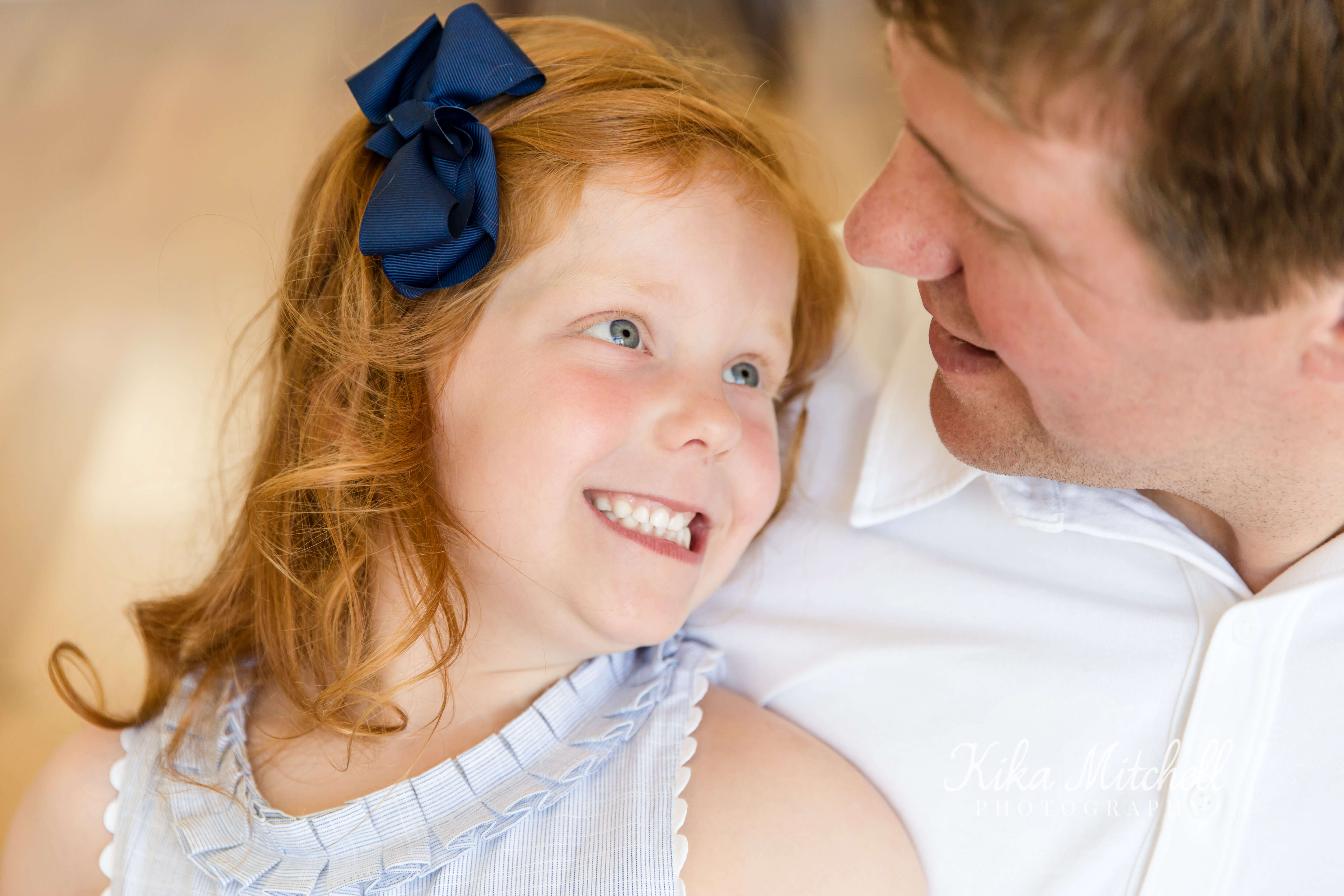 little girl with curl and daddy by Kika Mitchell family photographer Chelmsford Essex