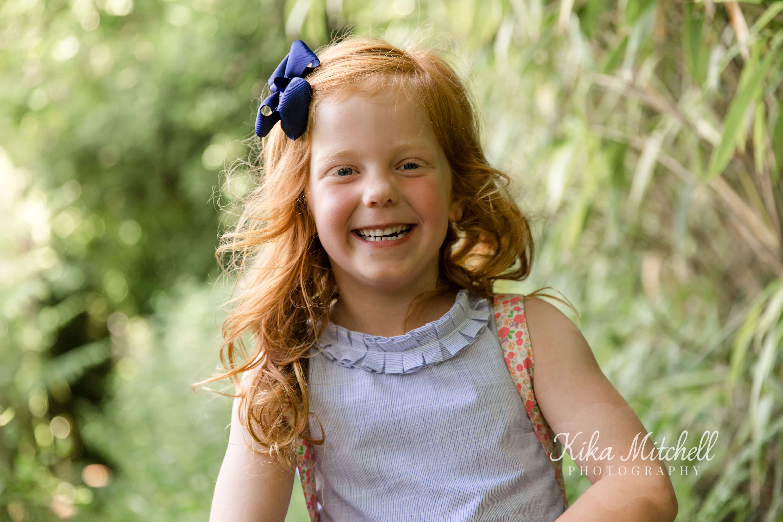 Joyful child by family photographer Kika Mitchell Photography Chelmsford