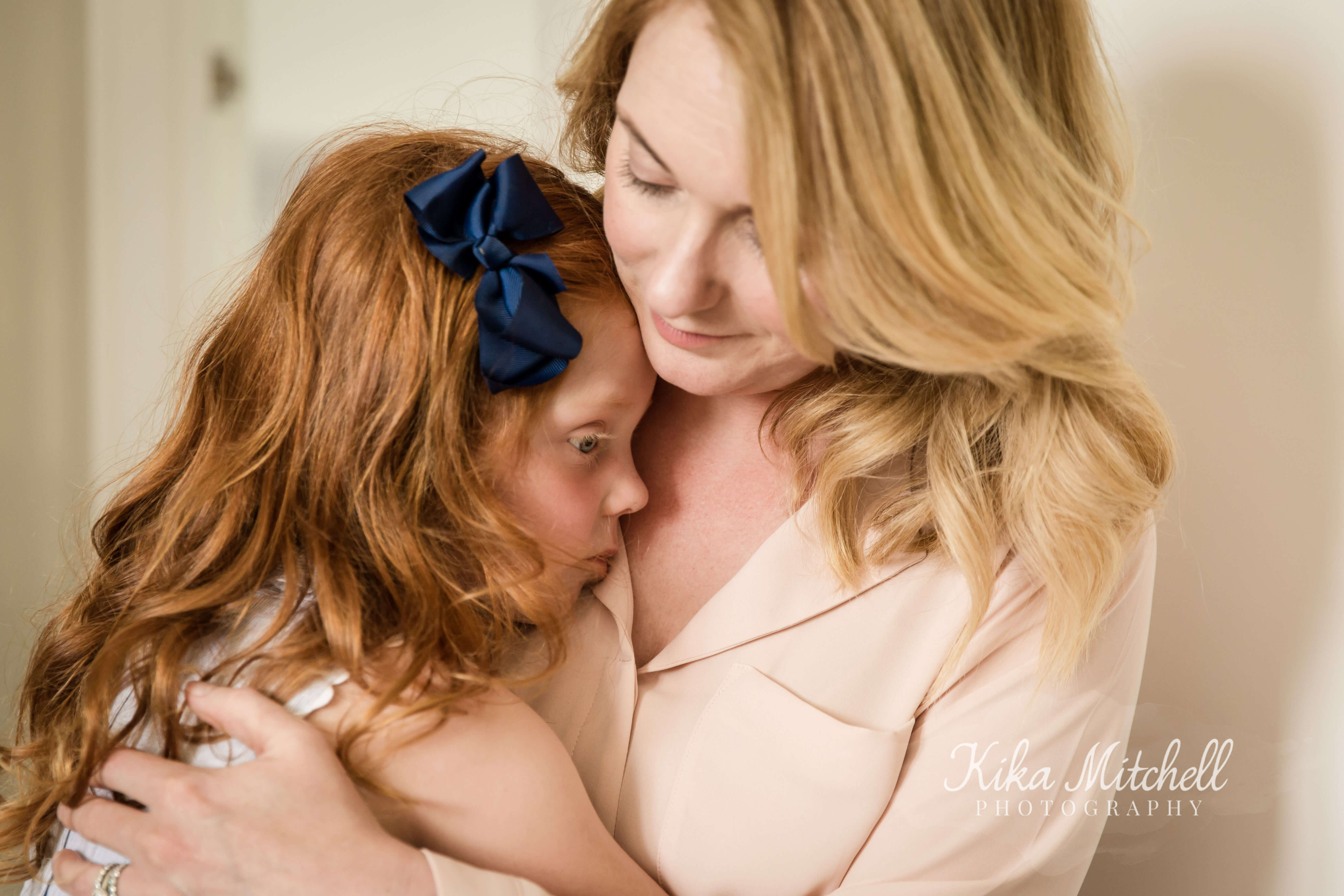 motherly embrace captured by Chelmsford photographer Kika Mitchell Photography on recent  newborn shoot