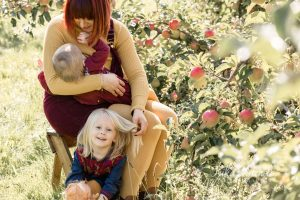 Breastfeeding mother Autumn mini sessions apple orchard by Kika Mitchell Photography Chelmsford photographer