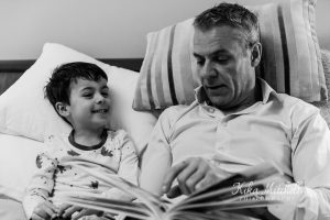 FATHER AND SON LOOKING AT PRINTING PHOTOGRAPH ALBUM BY KIKA MITCHELL PHOTOGRAPHY CHELMSFORD PHOTOGRAPHER