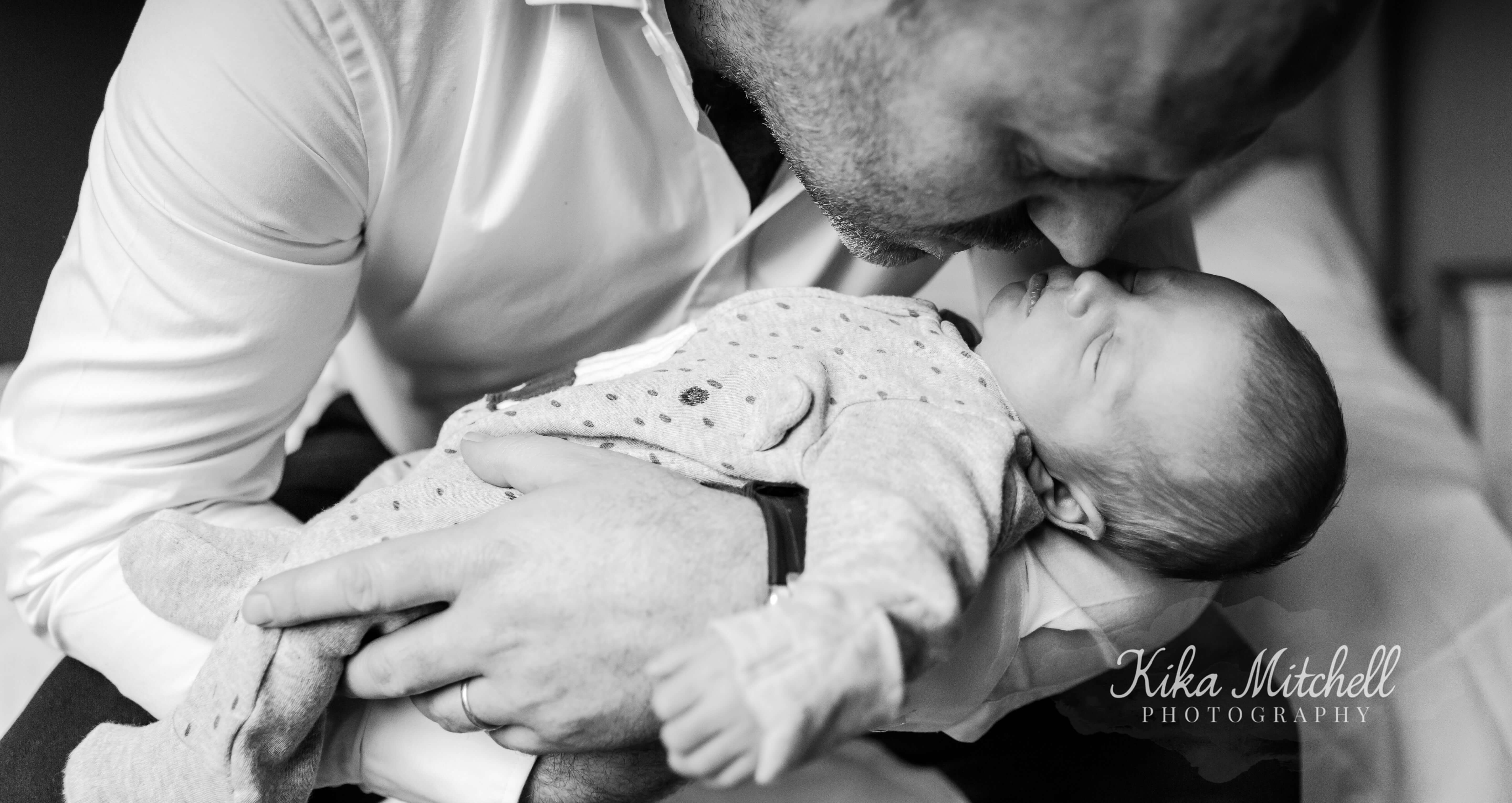 father and son monochrom portrait by Chelmsford photographer Kika mItchell photography