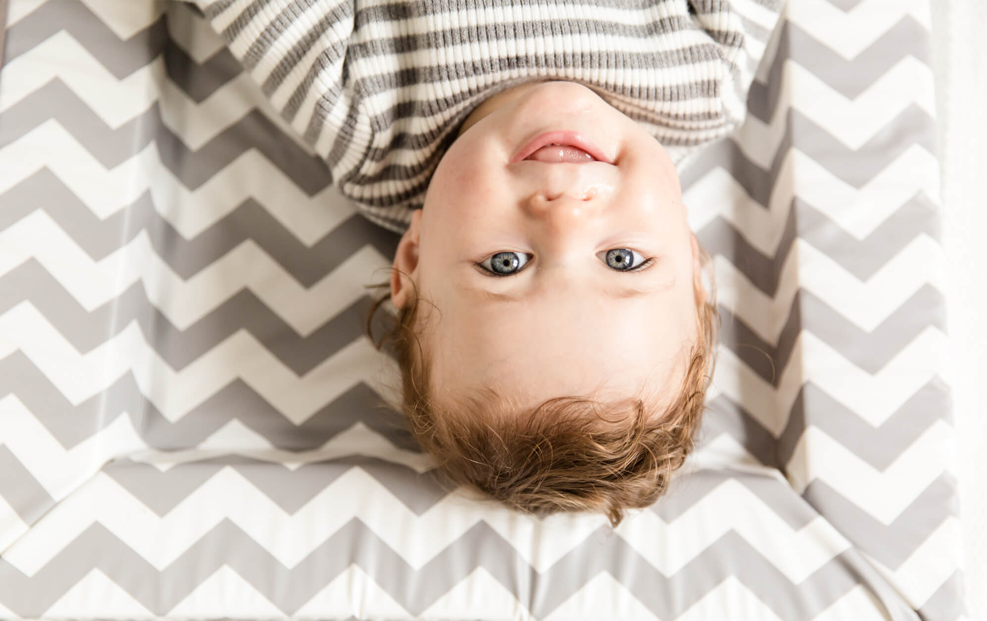 UPSIDE DOWN BABY BY CREATIVE CHELMSFORD PHOTOGRAPHER KIKA MITCHELL PHOTOGRAPHY