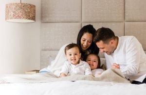 LIFESTYLE SHOT OF FAMILY ON BED CAPTURED BY CHELMSFORD PHOTOGRAPHER KIKA MITCHELL PHOTOGRAPHY