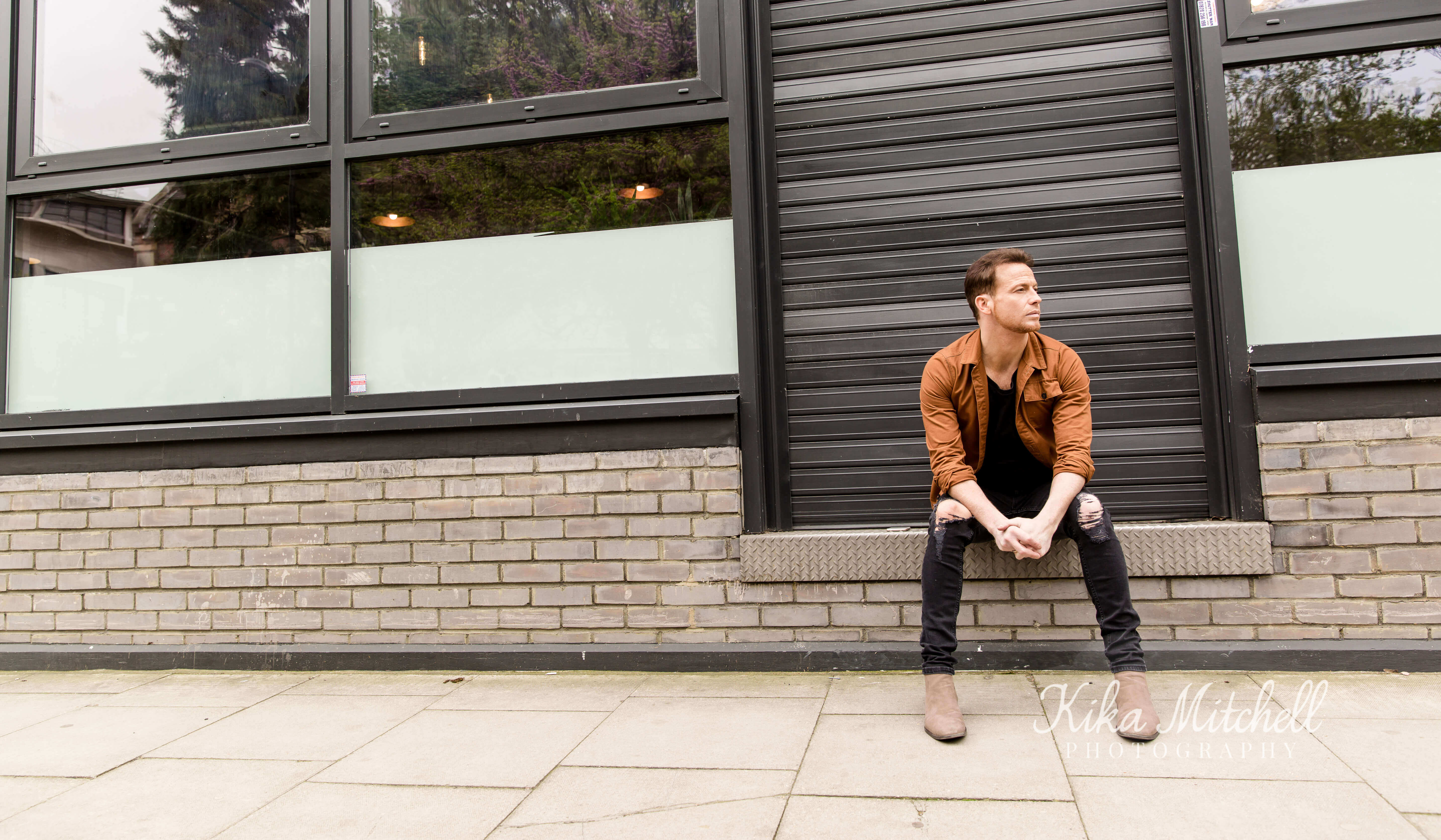 Joe Swash television presenter sat on wall on personal branding shoot by Kika Mitchell Photography Chelmsford Photographer