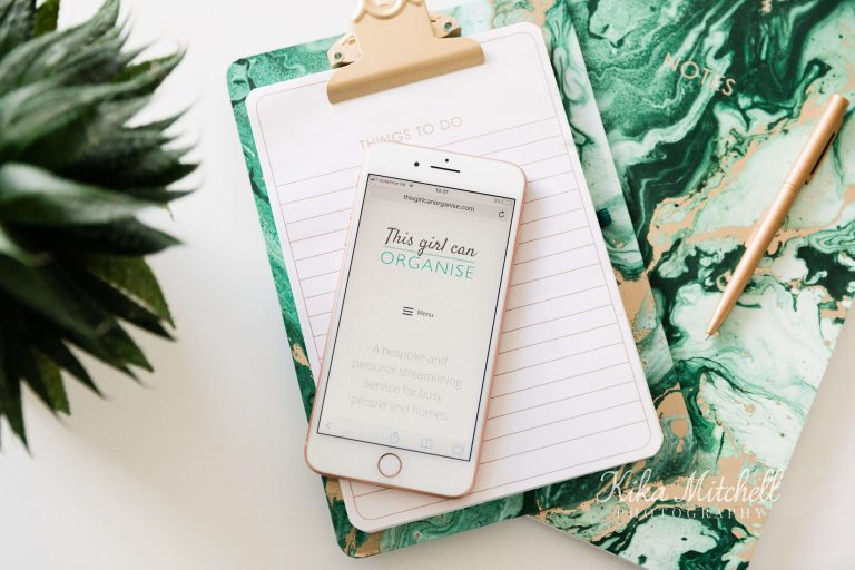 stylish flatlay of mobile phone on green marbled note book on personal branding shoot by Chelmsford photographer Kika Mitchell Photographer