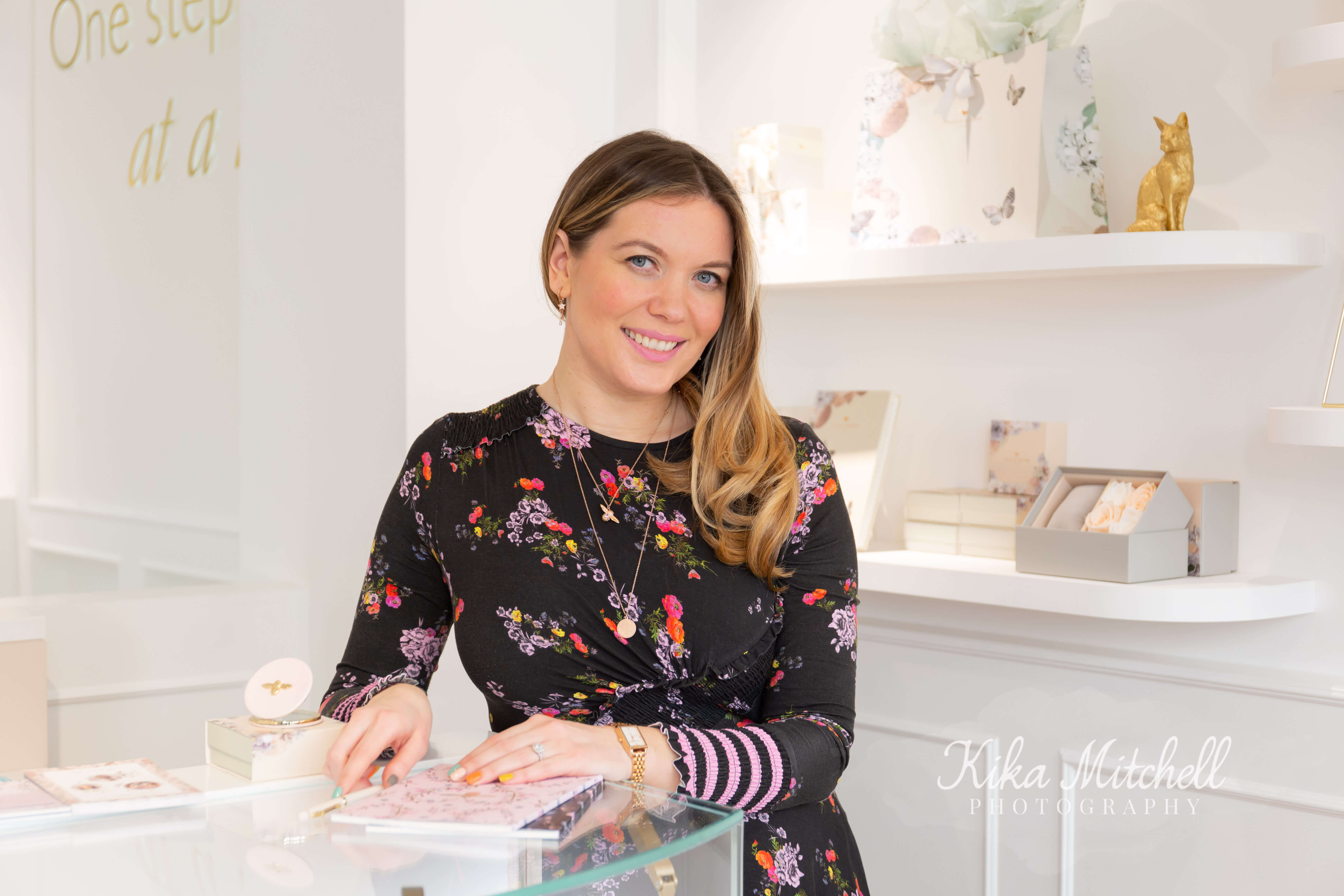 Jemma Fennings Olivia Burton co founder by till in shop celebrate kindness at Covent Garden boutique photographed by Chelmsford photographer Kika Mitchell Photography
