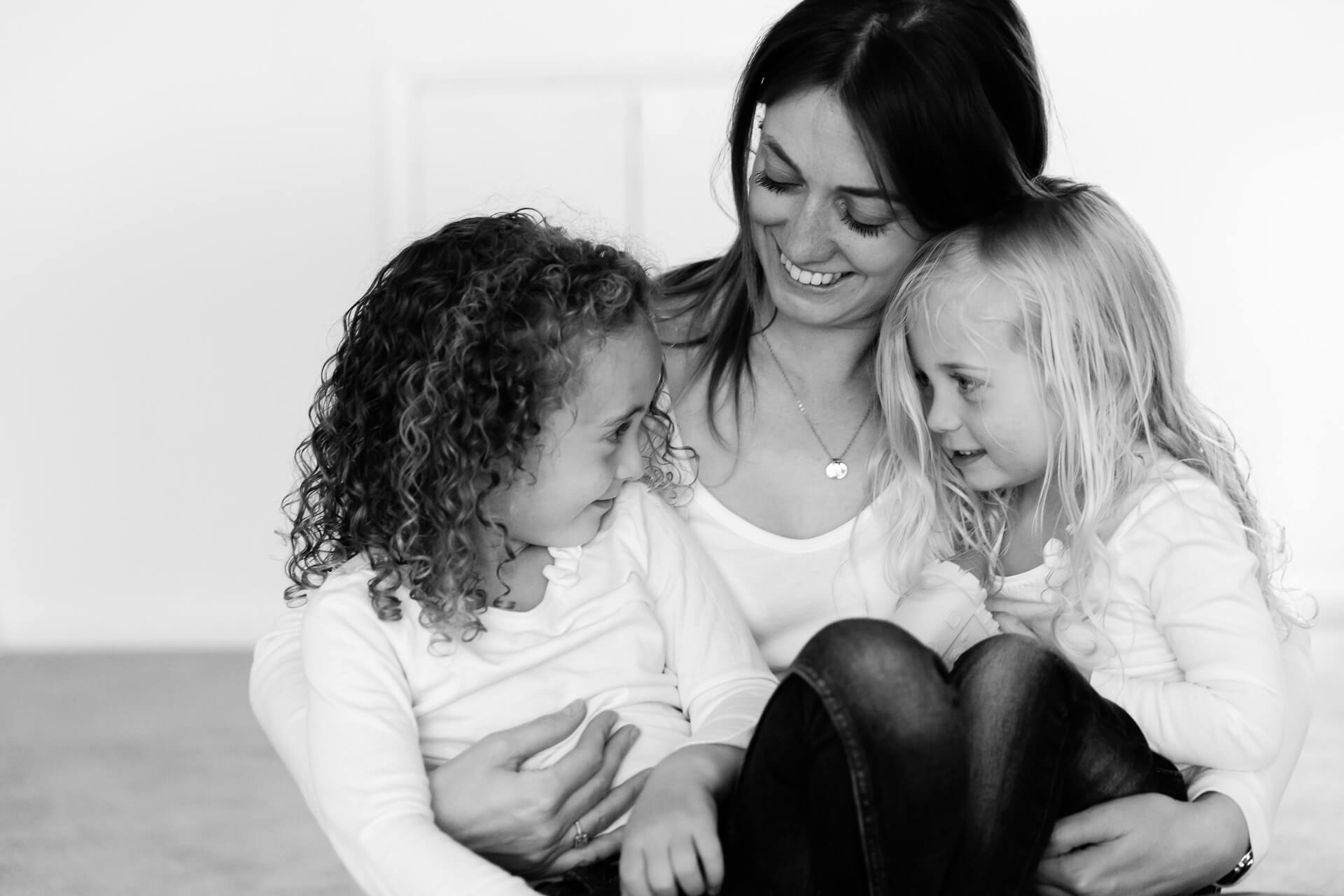 Monochrome image of mother and daughters in white tops captured by Chelmsford photographer Kika Mitchell Photography based in Essex