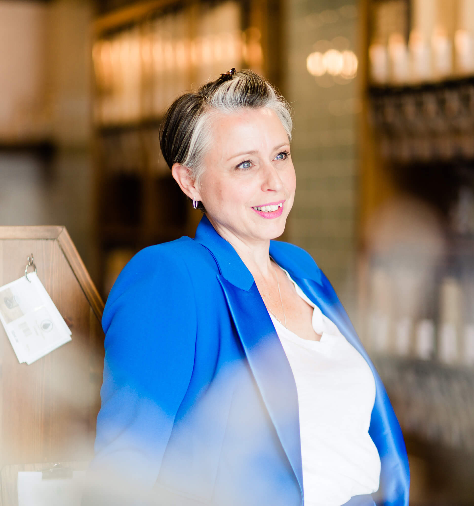 founder of Wear em out Lauren Derrett in bright blue suit captured by Chelmsford headshot photographer Kika Mitchell Photography