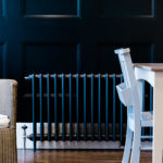 radiator, table and dark blue black wall photographed by Chelmsford photographer Kika Mitchell featured in Our dream kitchen blog
