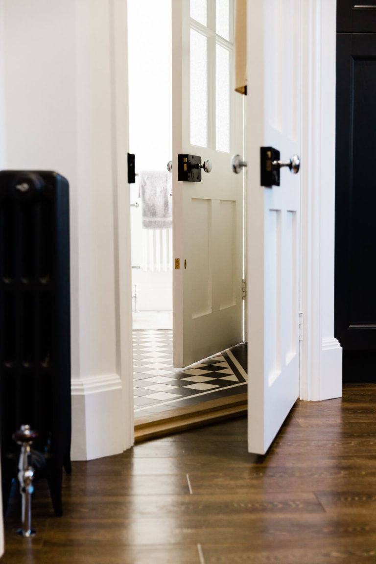 doorway featuring radiator and chequerboard floor in Our dream kitchen blog