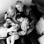 Emily Norris and her family on latest shoot in black and white shot on sofa taken by chelmsford photographer Kika Mitchell Photographer