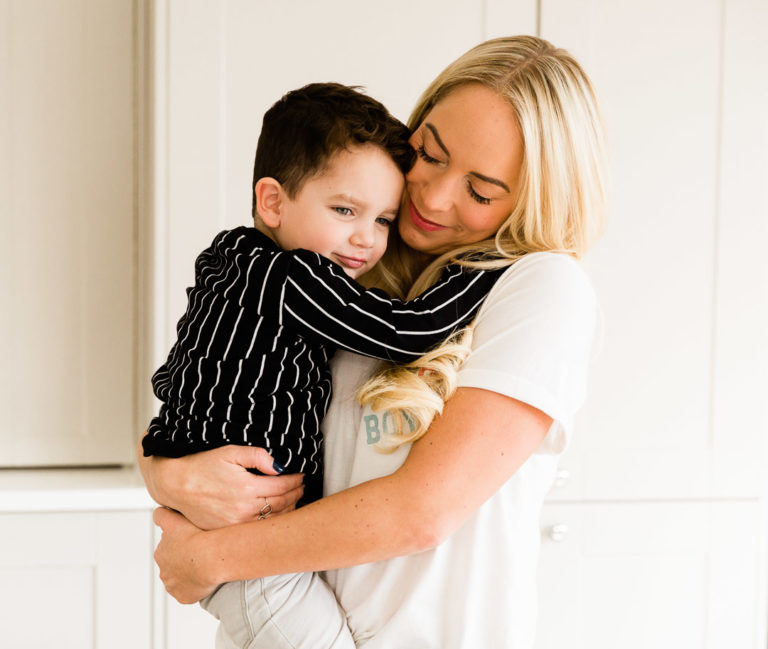 Emily Norris cuddles youngest son Jackson on latest family shoot in Brentwood captured by Chelmsford photographer Kika Mitchell Photography