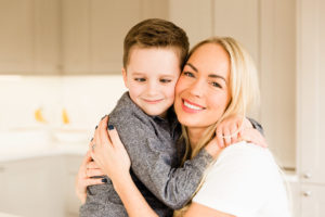 Emily Norris cuddles Caleb as he's cross eye'd on latest family shoot by Kika Mitchell Photography