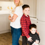 Emily Norris and sons compare height back to back on latest family shoot in Brentwood home by Chelmsford photographer Kika Mitchell Photographer