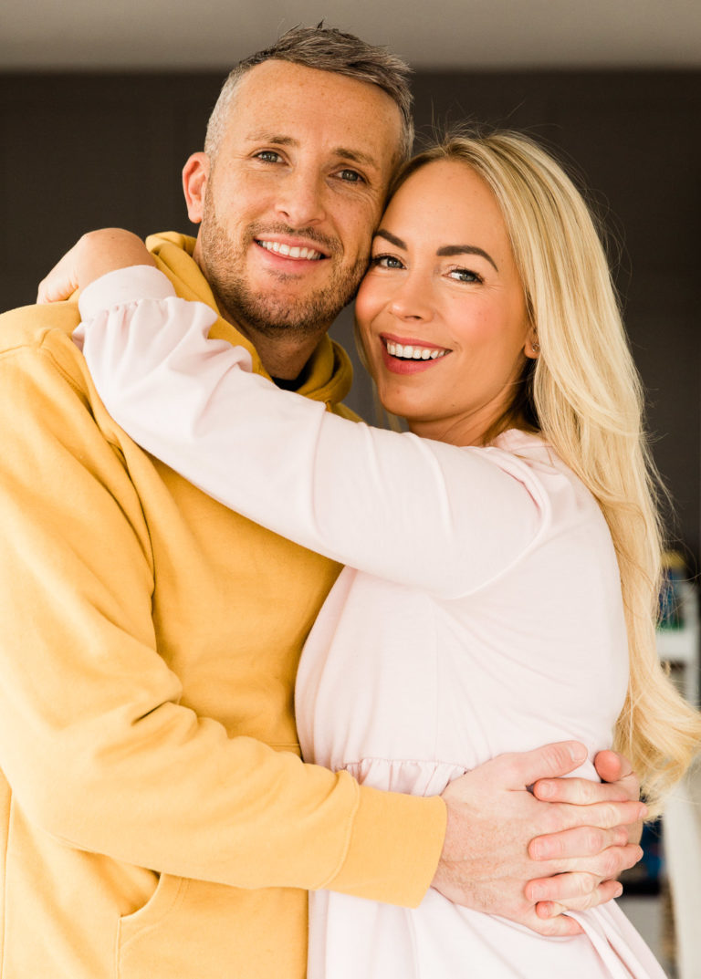 Emily Norris and husband cuddle in portrait image by Chelmsford photographer Kika Mitchell Photographer