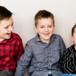 3 happy young boys taken on family photoshoot with Emily Norris by Kika Mitchell Chelmsford photographer