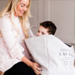 Emily Norris and youngest son in laundry bag taken on latest family shoot by Chelmsford photographer Kika Mitchell Photography