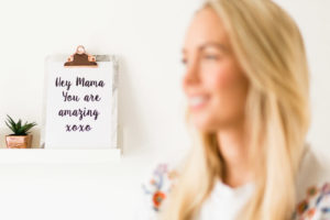 Emily Norris in defocussed foreground with sign in the background taken by Chelmsford photographer on latest family shoot in Brentwood Essex