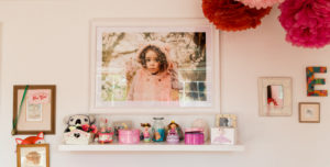 large white frame of little girl in blossom with curls taken by Chelmsford photographer Kika Mitchell Photography