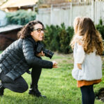 behind the scenes with Chelmsford photographer Kika Mitchell Photography on her personal branding shoot with child in garden