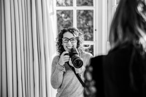 Behind the scenes with Kika Mitchell Photography on a family shoot with camera in hand photographing mother and daughter, Chelmsford Photographer