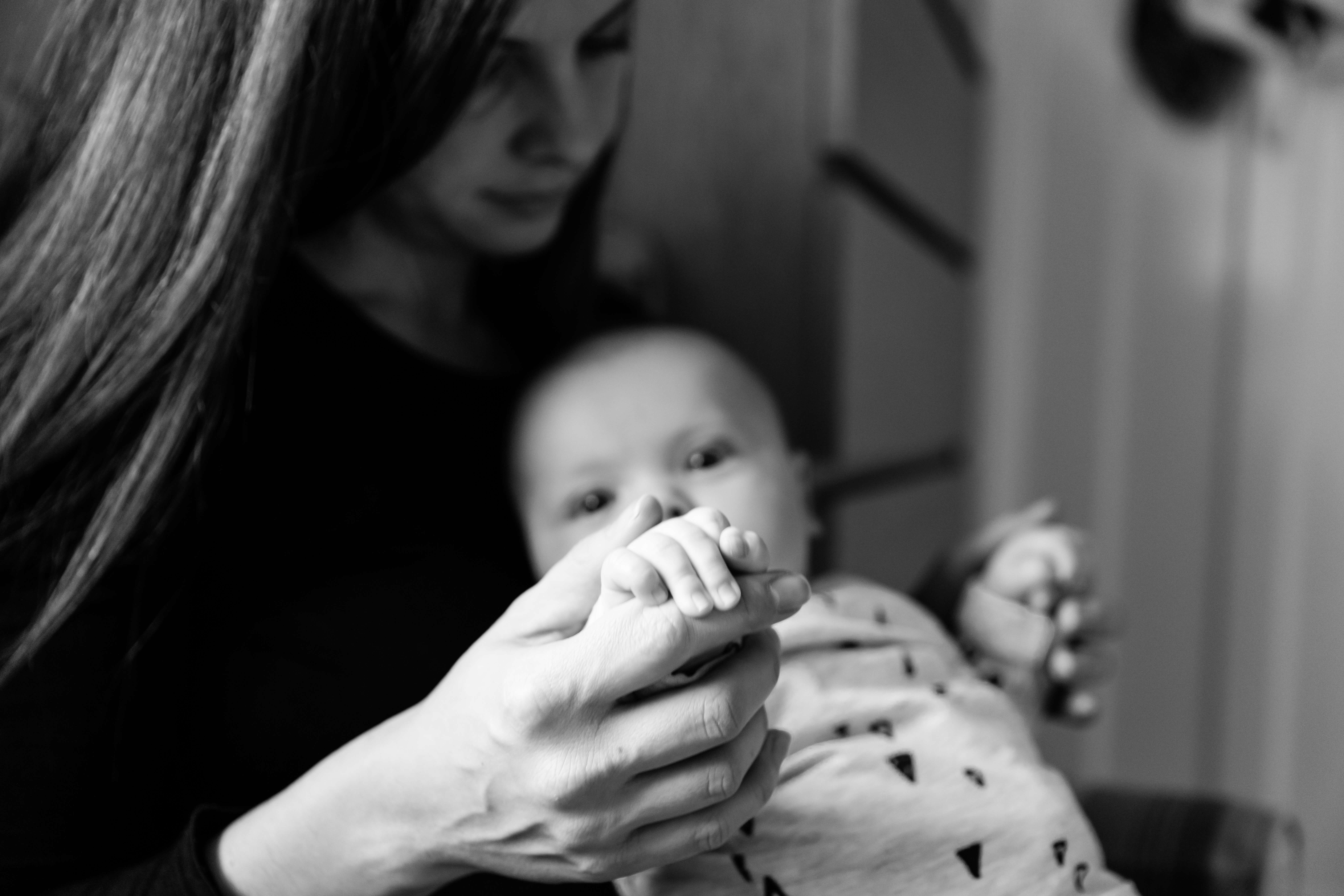 lockdown baby holding hands with mother by chelmsford photography Kika Mitchell Photography
