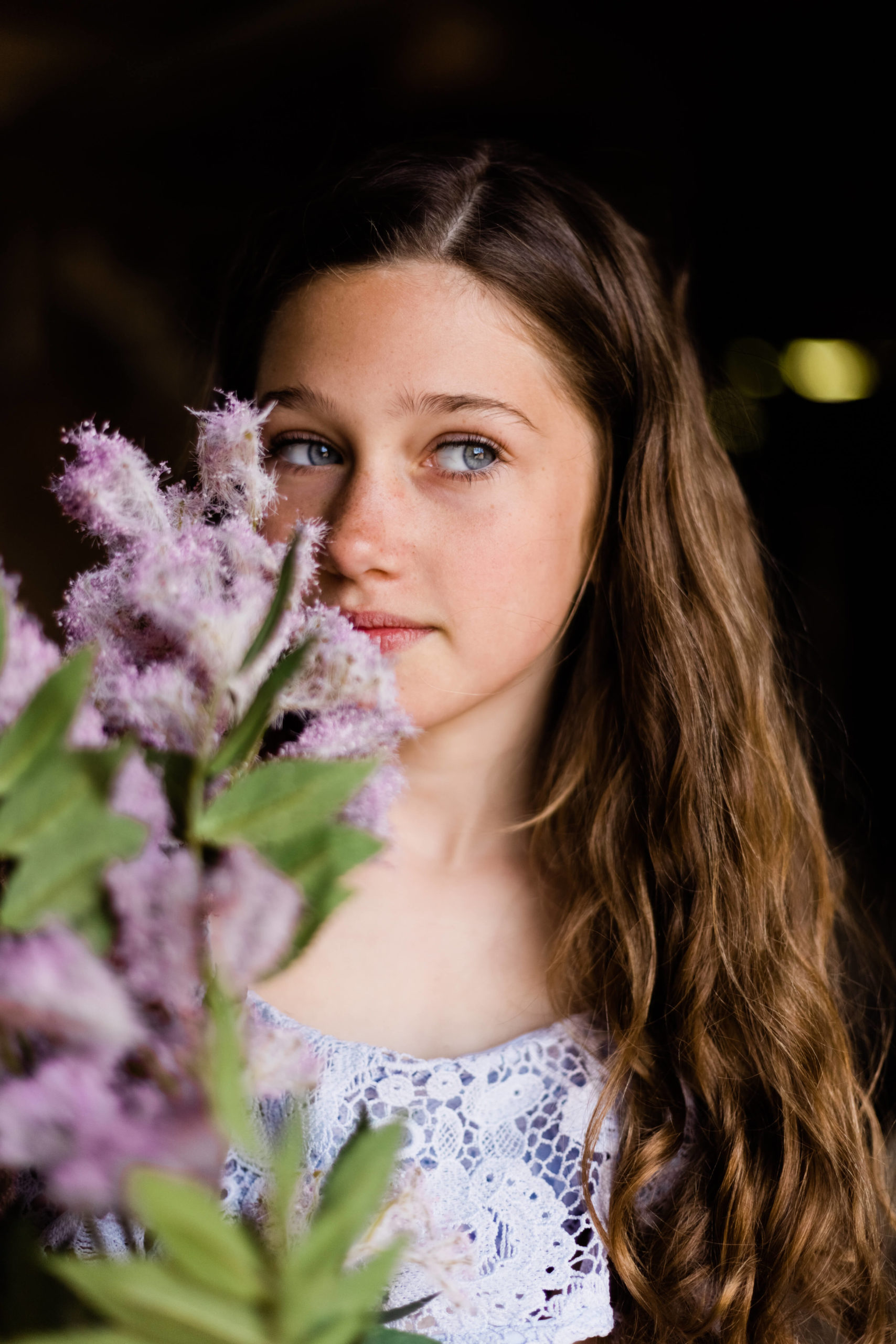 girl in blue dress with purple flowers captured by Chelmsford photographer Kika Mitchell Photography