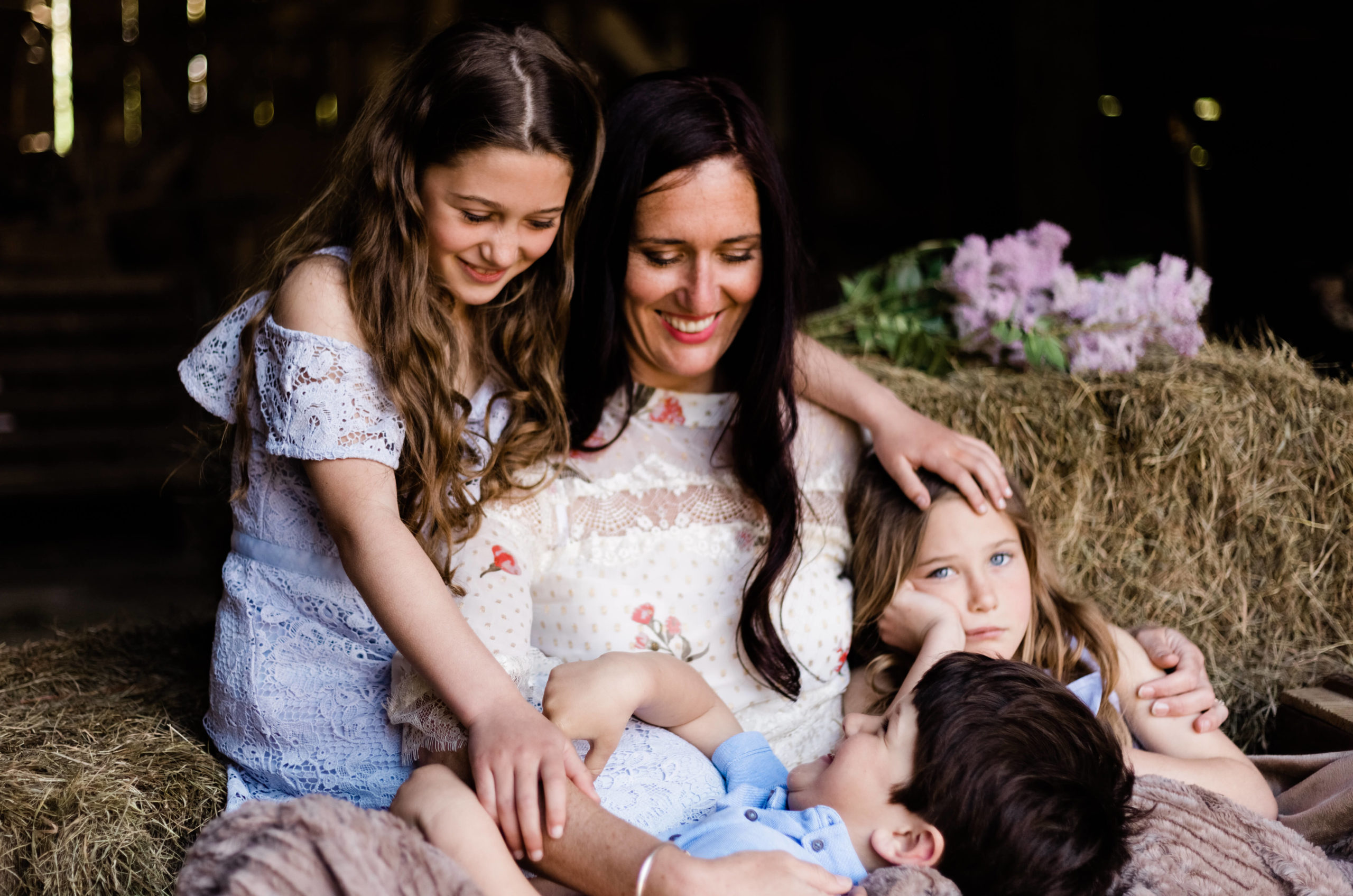 mother surrounded by children in colour portrait of motherhood by Kika Mitchell Photography