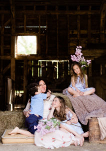 portrait of motherhood, mum surrounded by children, young boy cuddles her captured by Chelmsford photographer Kika Mitchell photography