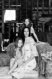 monochrome portrait of motherhood as 3 females look to left by Chelmsford photographer Kika MItchell