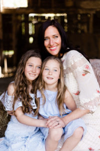 mother cuddles 2 daughters in colour image for portraits of motherhood by Chelmsford photographer Kika Mitchell photography