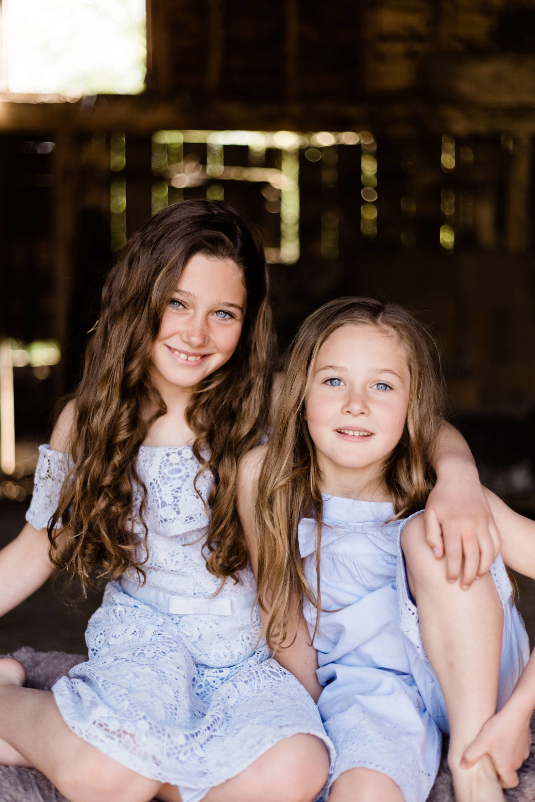 sisters in blue captured on portraits of motherhood shoot by chelmsford photographer Kika Mitchell Photography