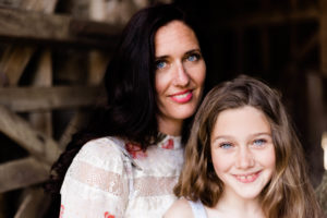 landscape image of mum and daughter in barn by Kika Mitchell photography Chelmsford photographer