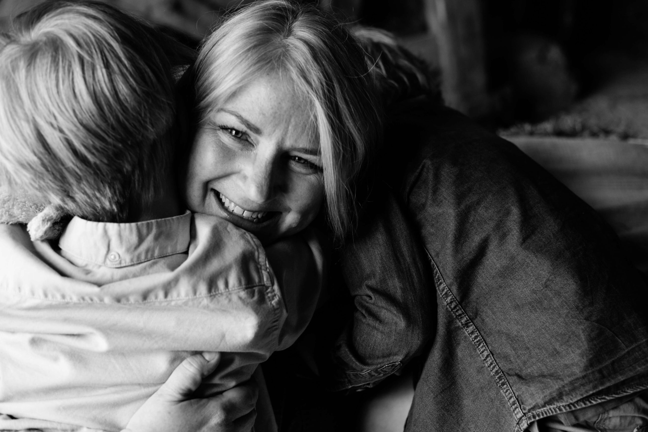 portrait of mother and hugging boys in black and white by chelmsford photographer Kika Mitchell Photography
